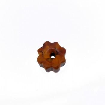 Particolare a stella in resina c/foro diam.circa mm 25