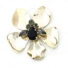 Fiore in metallo con pietre al centro