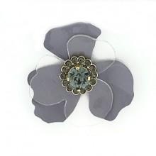 Fiore in metallo e plexi con pietra strass centrale